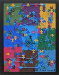 "Finding Focus -- Painted jigsaw puzzle, pins, threads, wire, beads, 20"" x 16"", © 2013"