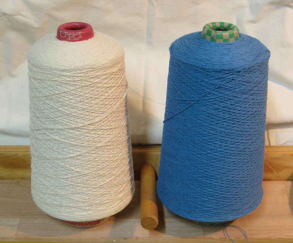 I started with these 2 cones of 8/2 matte cotton yarn.